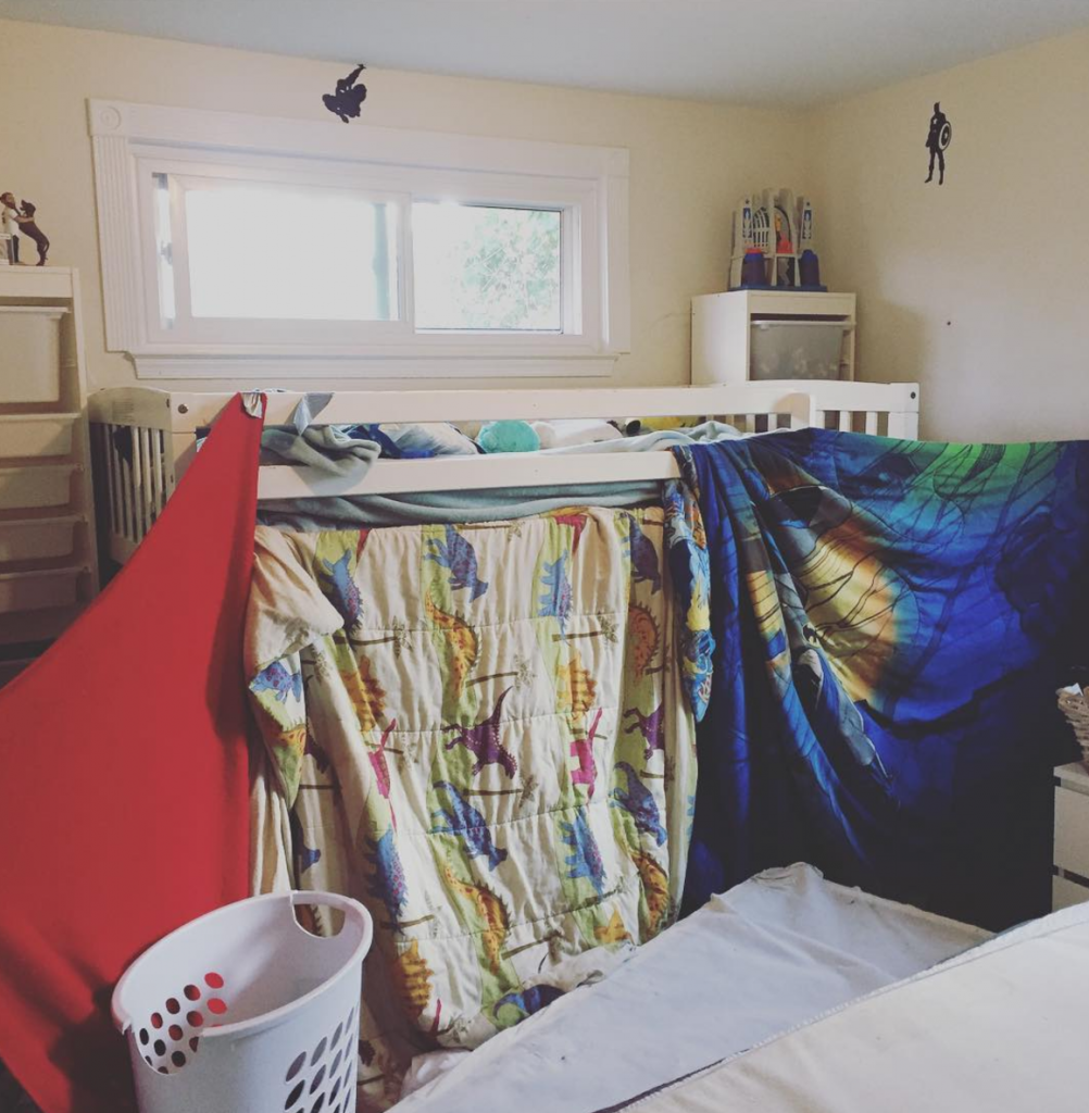 boys building bedroom fort